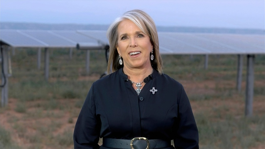 In this image from video, New Mexico Gov. Michelle Lujan Grisham speaks in front of solar panels during the third night of the Democratic National Convention on Wednesday, Aug. 19, 2020.