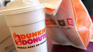 Dunkin' Donuts coffee and to-go bag.